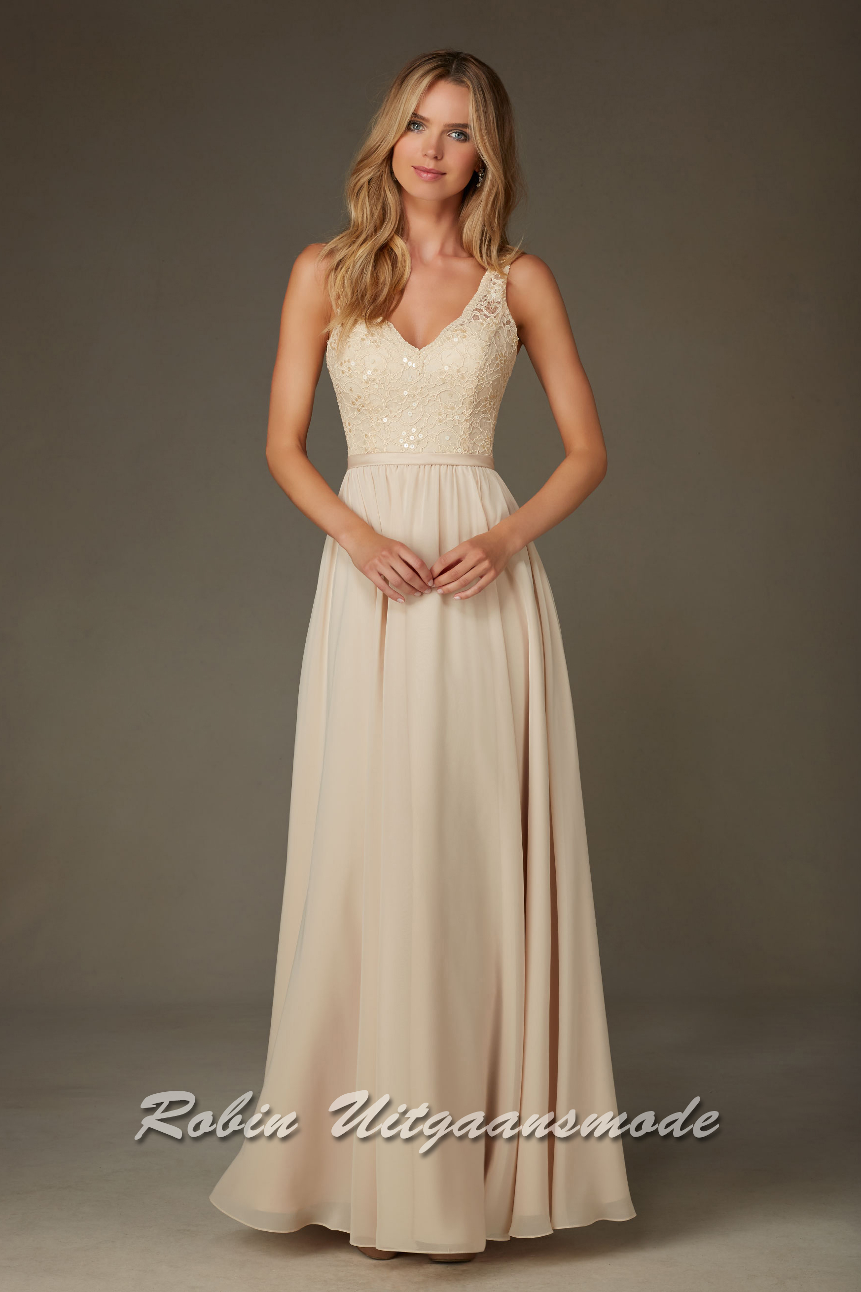 1d2418ec1f Elegant wedding dress with a beaded lace, V-neck bodice with flowy skirt.
