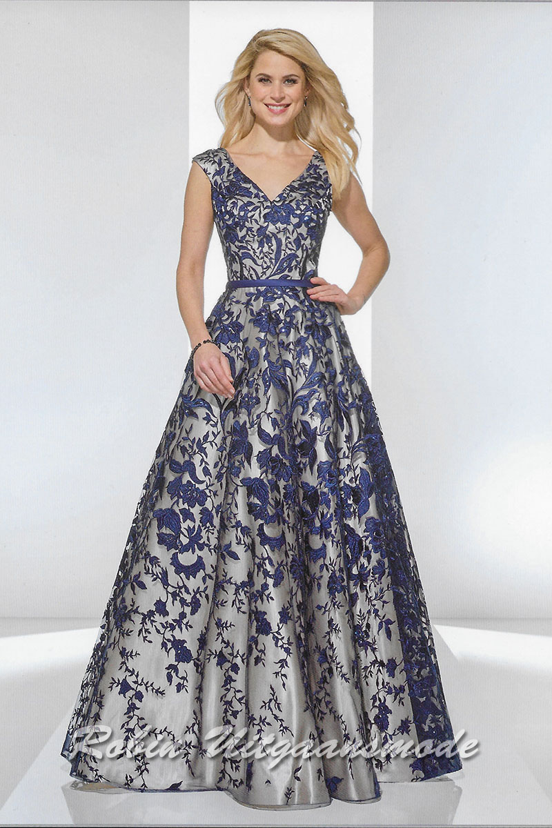 e2ed8fceabe1 Colourful A-line evening dress with blue motif on a lace top layer, the