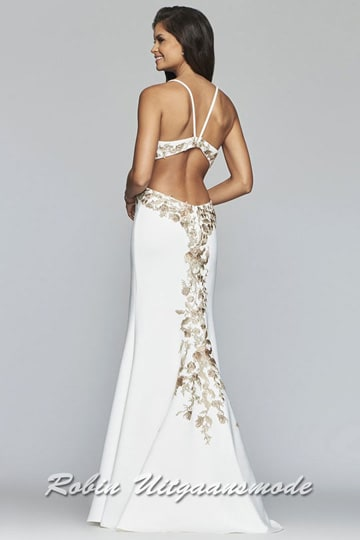 Modern sleek dress with a low back in ivory white with bronze coloured flower details. | modelnr b-4-4