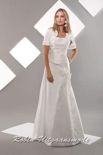 Modern white wedding dress features a decorated flary skirt, draped bodice and bolero jacket with half-long sleeves | modelnr b-a2-12