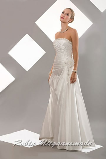 Lovely draped white dress with a straight strapless buster and floral applique on the waist | modelnr b-a2-14