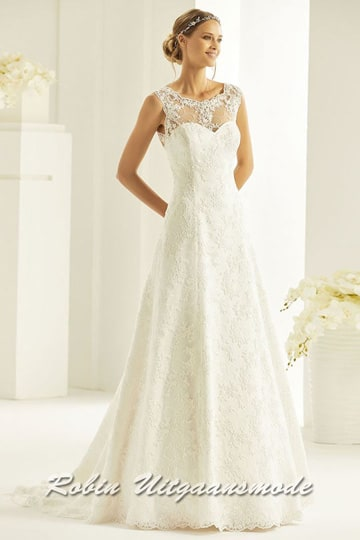 A-line wedding dress with embroidered lace layer over the heart-shaped bodice, the V-neck open back and skirt with drag | modelnr b-i4-2
