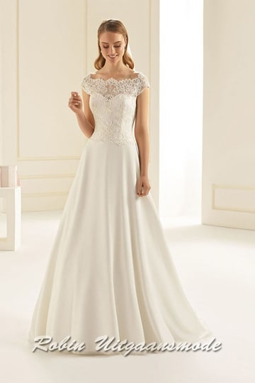 A-line wedding dress with boat neckline, features a heart-shaped bodice is completely covered with lace and a chiffon skirt with a small train. | modelnr b-i4-7