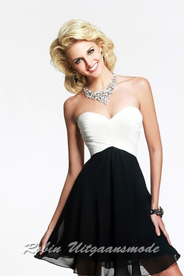 Lovely short dress, the white strapless structured bust with fine ruching and black mini skirt gives a simple and elegant look | modelnr c-1-57