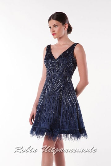 Black short dress, beautifully beaded with silver sequins, a modest V-neck and feathers on the hem of the skirt. | modelnr c-a1-71