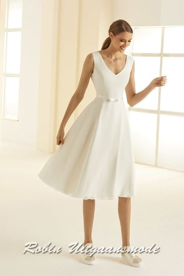 A-line short wedding dress with a wide skirt that falls over the knee, the bodice has a modest V-neckline and a beautiful V-shape low back | modelnr c-b1-10