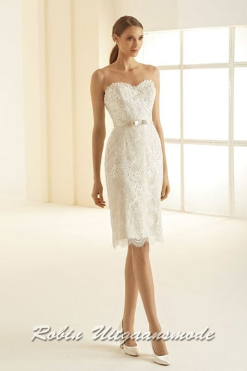 Short wedding dress with lace appliqués, the bodice has a heart shaped top with a boat neckline and a low-cut back | modelnr c-b1-11