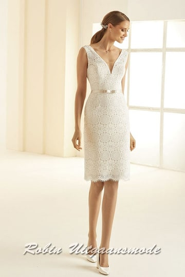 Straight wedding dress covered by lace with a fine pattern and a short skirt till the knee. | modelnr c-b1-9