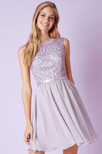 Cheerful lilac purple dress with lace, a high neckline and sleeveless bodice | modelnr c-ul1-44