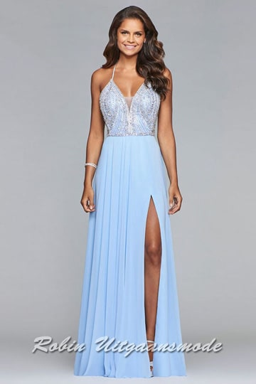 Light blue prom dress with richly beaded bodice, a supple chiffon skirt with a split and a low back with criss-cross lacing. | modelnr g-2-197