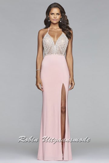 A fitted style prom dress features a flirty v neckline and breathtaking  bodice adorned with sequins 72ea7469d