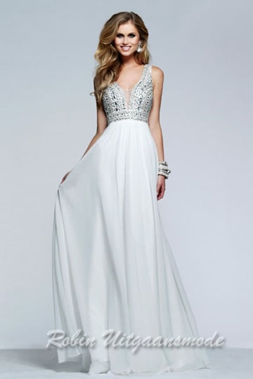 Stunning prom dresses features a fully beaded bodice with a illusion deep V-neck | modelnr g-2-96
