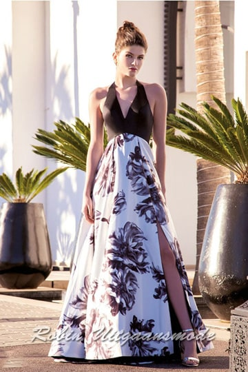Flower print prom dress with a black V-neck bodice, the white skirt has a print with black large flowers and a high slit | modelnr g-a2-32