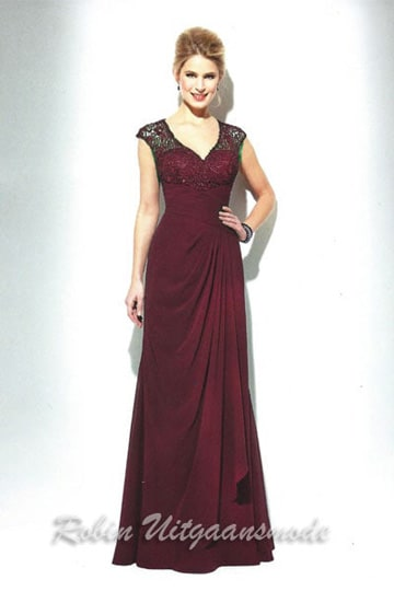 Luxurious plsu size evening dress features a beaded buster, draped waistline and small cap sleeves | modelnr g-u2-100
