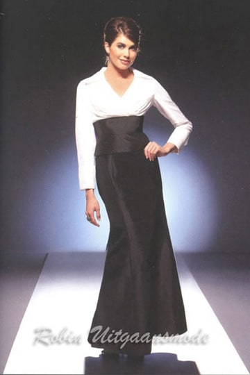 Elegant evening dress features a white bodice with long sleeves and black long skirt | modelnr g-u2-13