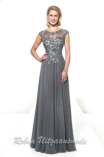Elegant grey evening dress features a overlay embroidered lace bodice with high neck line and cap sleeves | modelnr g-u2-15