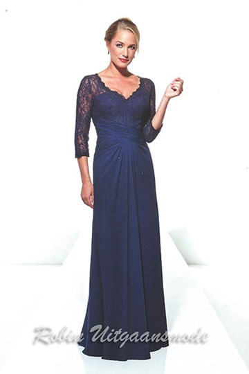 Stylish dark-blue evening dress with lace buster overlay and long sleeves, the flowy fabric is draped around the waist | modelnr g-u2-18
