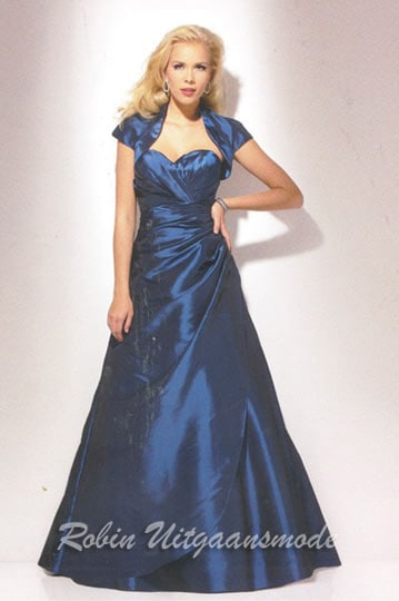 Stylish blue evening dress features a strapless bodice, A-line skirt with tule and short bolero jacket | modelnr g-u2-37