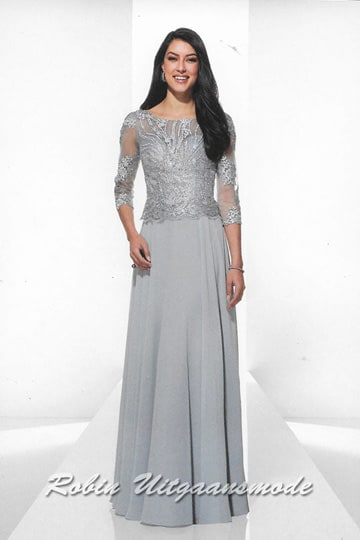 Elegant evening dress in a silver colour with a lace overlay bodice, high neck and a long lace sleeve. | modelnr g-u2-6