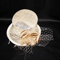 Cream hat on diadem with decorative feathers and mesh